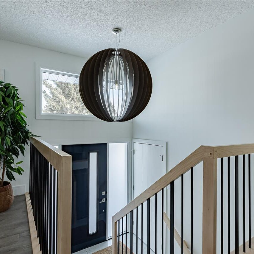Front Entry / High Gloss Painted Door / Dramatic Light Fixture / Maple Lacquer Railings